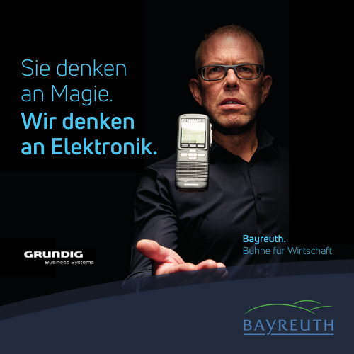Sie denken an Magie. Wir denken an Elektronik. GRUNDIG Kampagnenmotiv Bayreuth. Bühne für Wirtschaft.